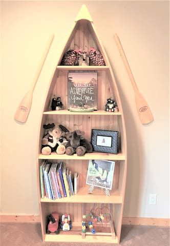 A variety of books and toys conveniently located in this room.