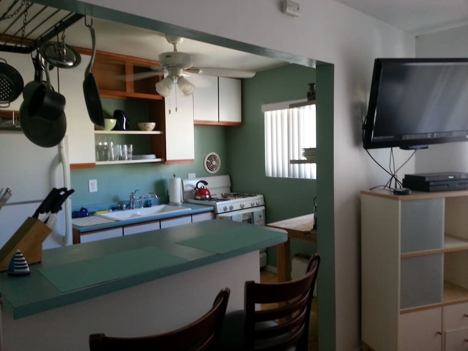 full size open kitchen with gas range full size frig and eating area