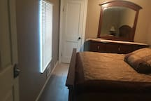 Private bedroom with nightstand lamp, tv with cable and netflix, closet with extra linens and dresser.