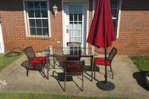Outdoor patio with seating area provides additional eating & lounging space for our guests. Patio faces west so mornings are shaded and evenings expose sunsets glow.  Corner lot so no neighbor on the north & privacy fence on west & south side of yard