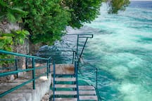 Just below our villa you have access to the marine sanctuary, literally just below these steps! Snorkel all day long.
