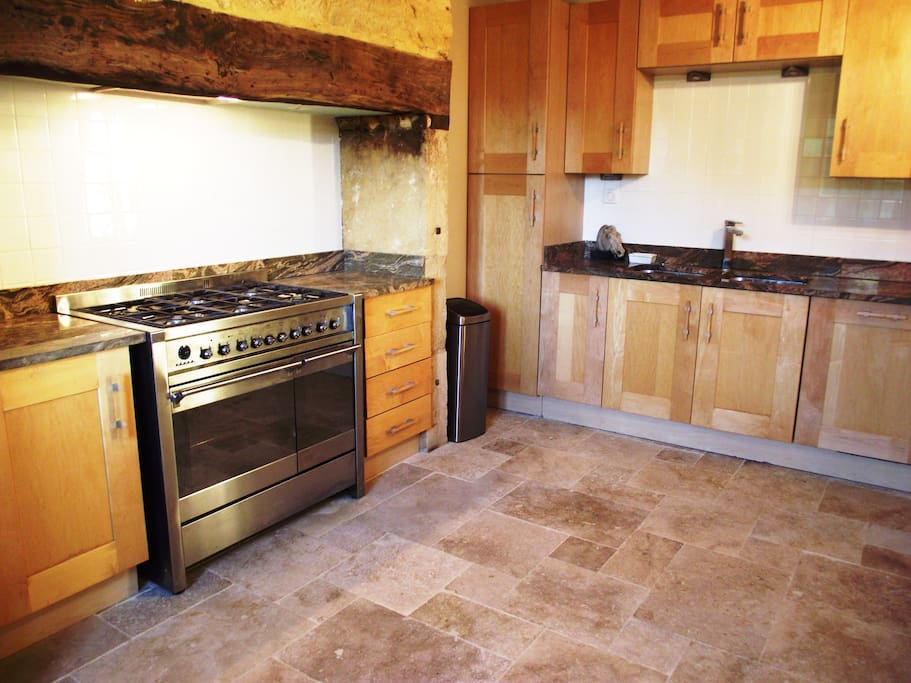 Main house - Fully fitted kitchen with double oven, gas hob, dishwasher, fridge freezer, microwave, kettle, coffee machine, breakfast bar, waste disposal all with granite worktops & limestone flooring,