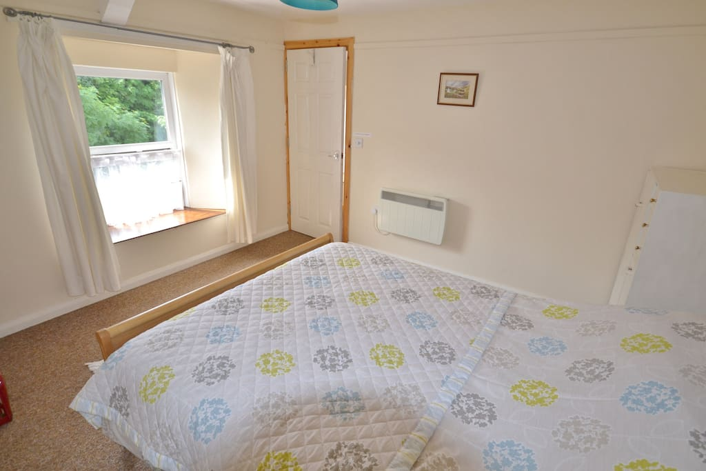 Bedroom with kingsized bed and 2 singles and cot available