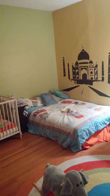 Kids bedroom with crib and full size bed