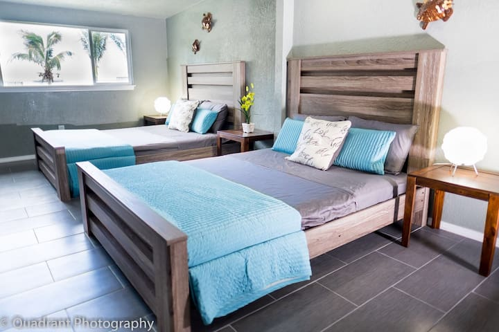 Bedroom #2 features two Queen beds with memory foam mattress.  Pillows and mattresses have mite free and bedbug free features.  Great for people with allergies to dust.  Room is also equipped with personalized AC control.