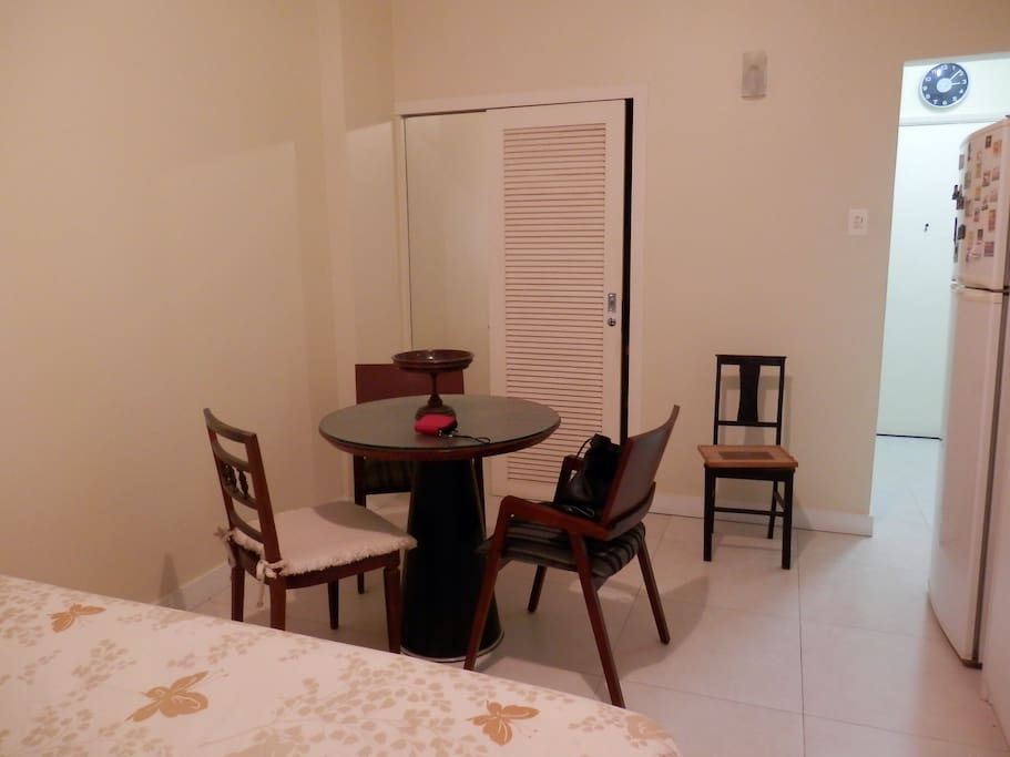 Refrigerator, table with chairs, private bathroom