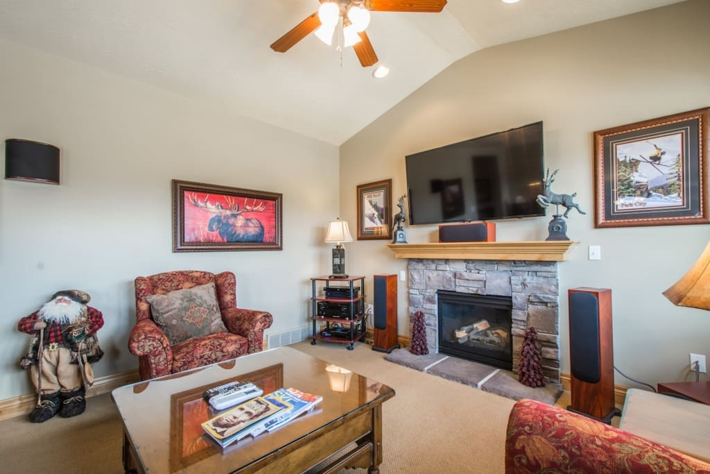 """The living room features all the furnishings and technology you could want - large leather couch, fireplace and 55"""" HDTV w/ Direct TV, surround sound."""
