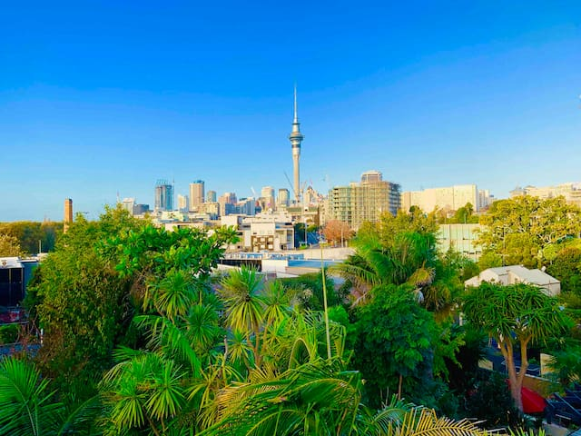 Enjoy the spectacular view of The Sky Tower from your bedroom window ... 328 meters high, an icon of Auckland's skyline for almost 20 years ... about a 20 minute walk from home.‍♂️‍♀️ 1907 Victoria Park Market's 38 metre brick chimney is on the left side.