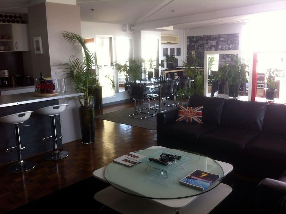 Upstairs is one huge (180sqm) open plan space with, kitchen, two lounge areas, dining table for 6 people... it's by far the most spacious Penthouse on Airbnb.