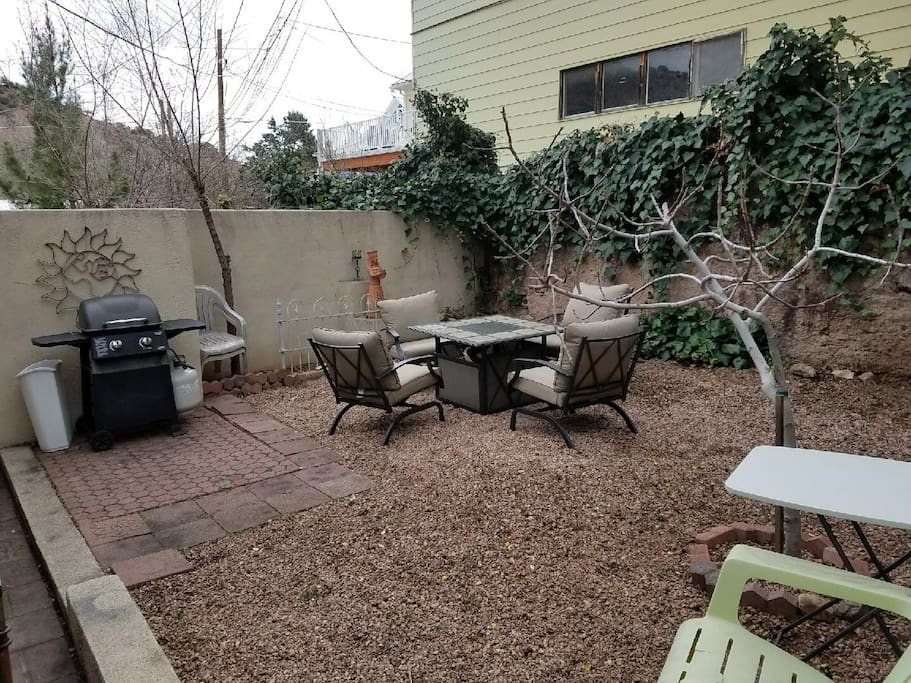 Back yard equipped with propane grill & fire pit