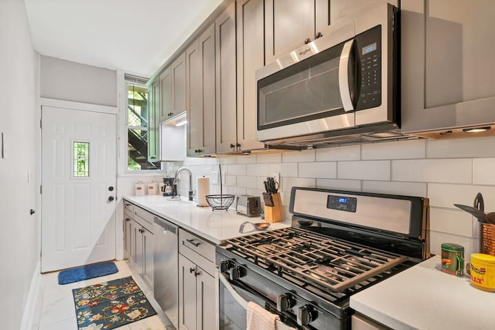 Full kitchen with new stainless steel appliances for all of your cooking needs.