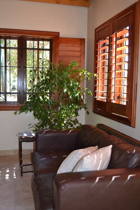 The wooden shutters let in the warmth of the midday sun