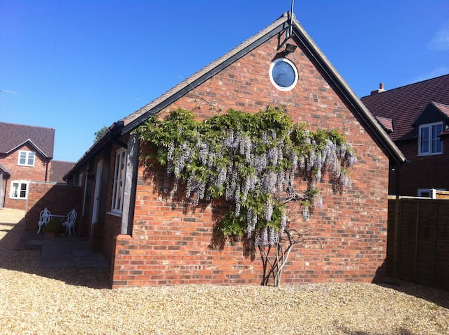 Cottage covered in Wisteria