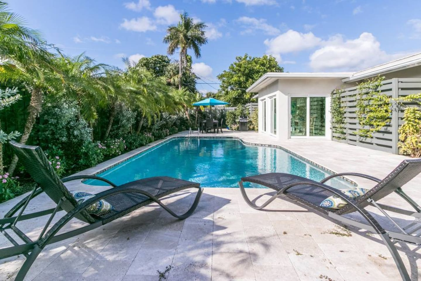 Loungers by private tropical pool.