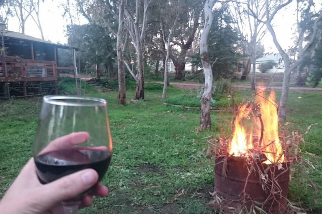 Sunset, local red wine and a fire