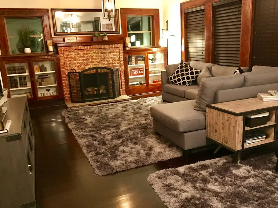 Cozy living room with TV, wifi, book cases and comfortable seating.