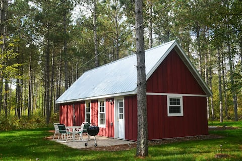 Cabin nestled in the Pine Grove on the Pine River.