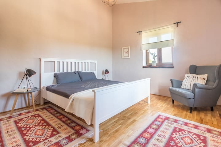 Upstairs bedroom 2 with garden and olive grove view