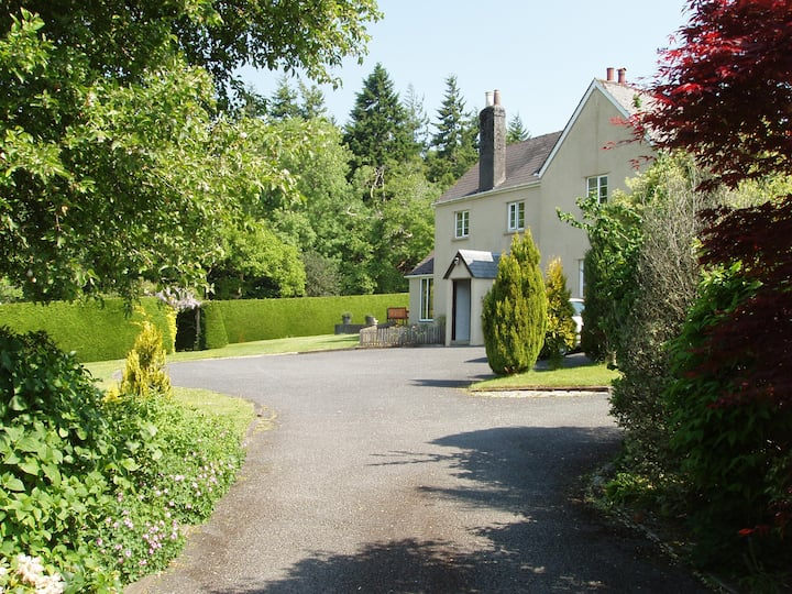 Old beamed Devon Farmhouse with beautiful gardens.