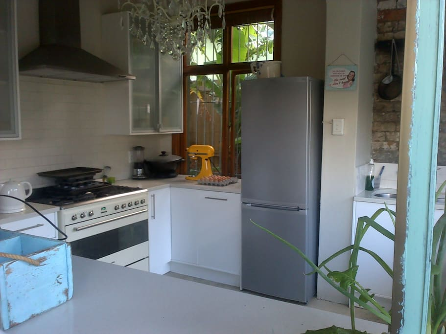Kitchen with Smeg oven, fridge, kettle etc