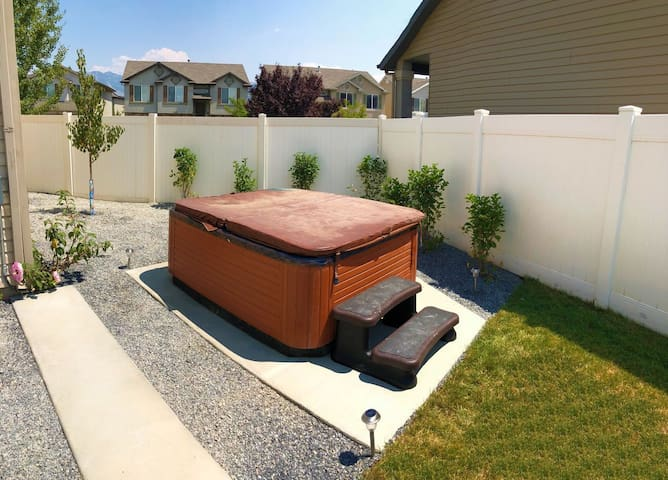 Large hot tub in the private back yard