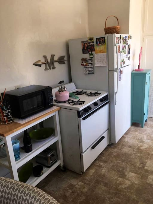 Kitchen with fridge, stove top cleaner oven, microwave, toaster, and Keurig