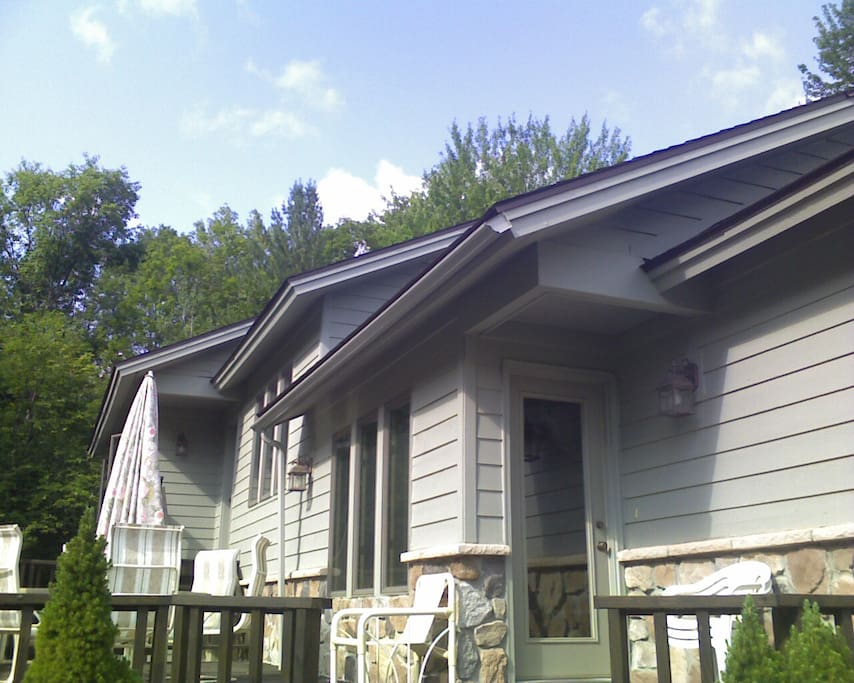 back of house with deck