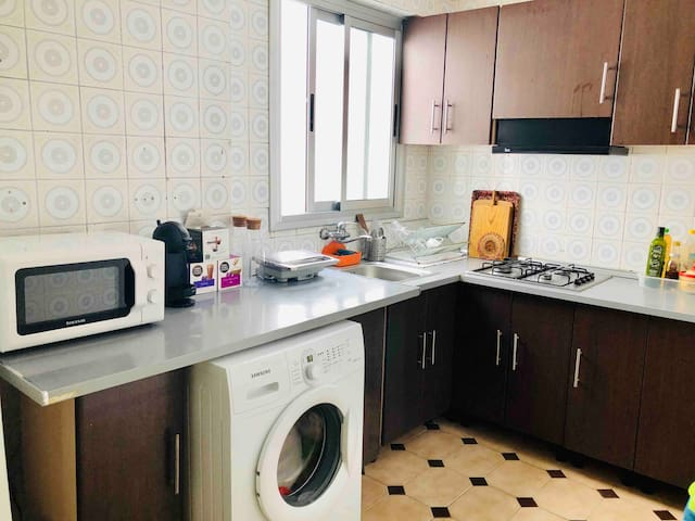 Kitchen equipped with; coffeemaker, microwave, toaster, hot and cold water, fridge, wash machine, etc..
