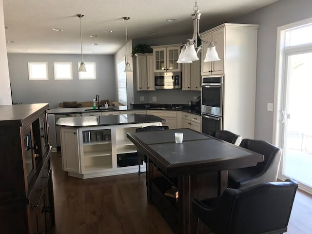 Full spacious kitchen with refrigerator, freezer, microwave, double oven.