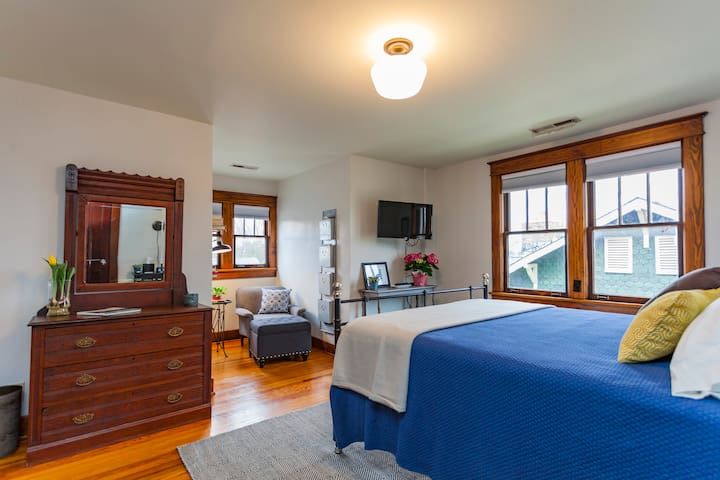 The bedroom features both modern design and antiques.