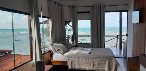 Casa em frente ao mar.
