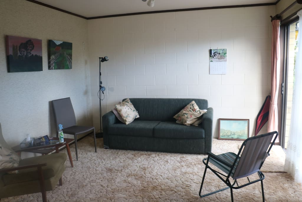 Lounge with suite & chair Coffee Table & reading lamp.