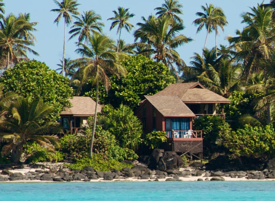 From the lagoon looking in @ Muri Beach Cottages with the Pole House in front