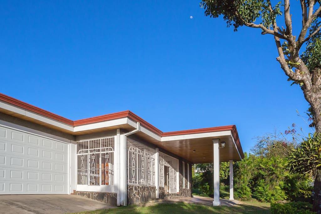 Garage door, terrace and external parking areas in garden.