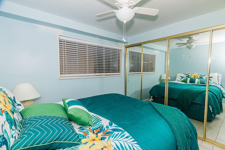Second bedroom with huge closet and mirrored closet doors.