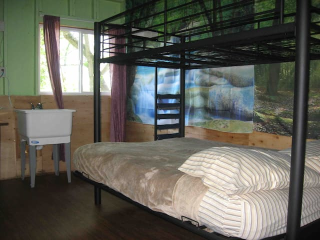 Full bed on bottom bunk, storage on top. Top bunk can be fitted with a mattress for long term for guest preference.