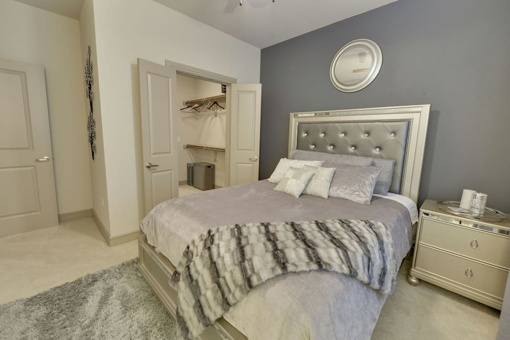 Bedroom 1~ Hollywood style furniture with memory foam topper and West Elm bedding for a relaxing nights sleep. This room has a large master bath attached. Top of the line room with your comfort in mind.
