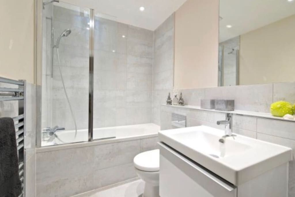 private bathroom with both shower and bath, amenities provided