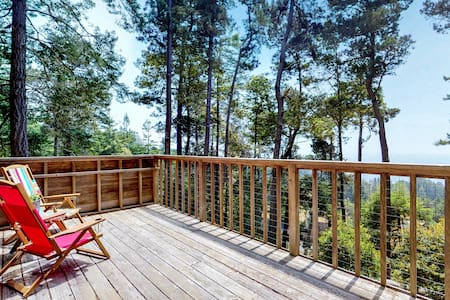 Historic cabin w/ woodstove, deck with ocean views, and shared pools/tennis!