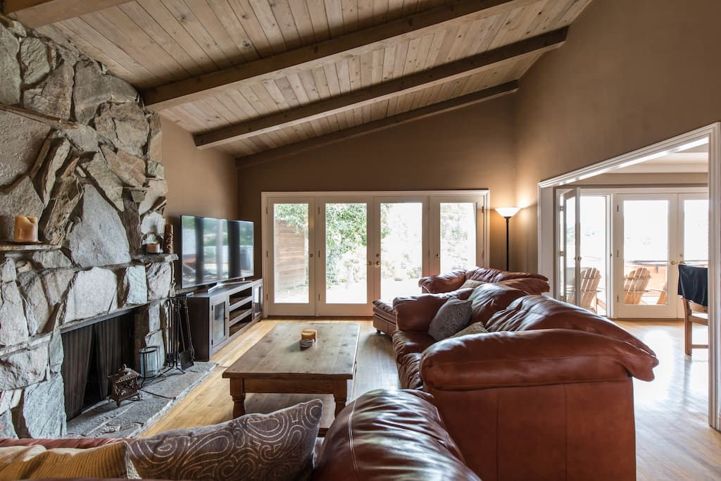 """Living Room with high ceilings. 65"""" HD TV with HBO and Showtime included."""