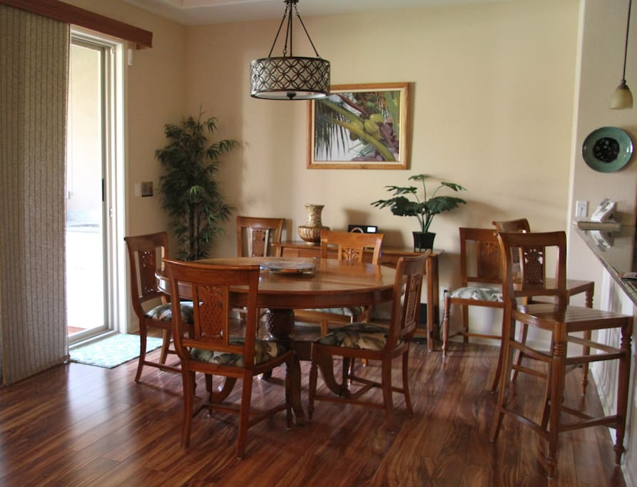 Dining area (as viewed from living room) w/access to lanai w/BBQ.
