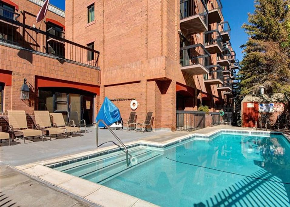 A sparkling outdoor heated pool is available in the building