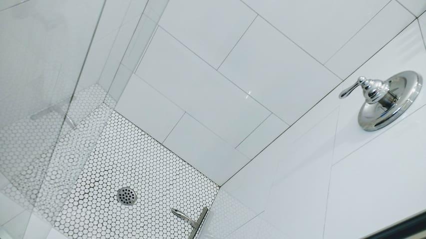 Shower with glass door.