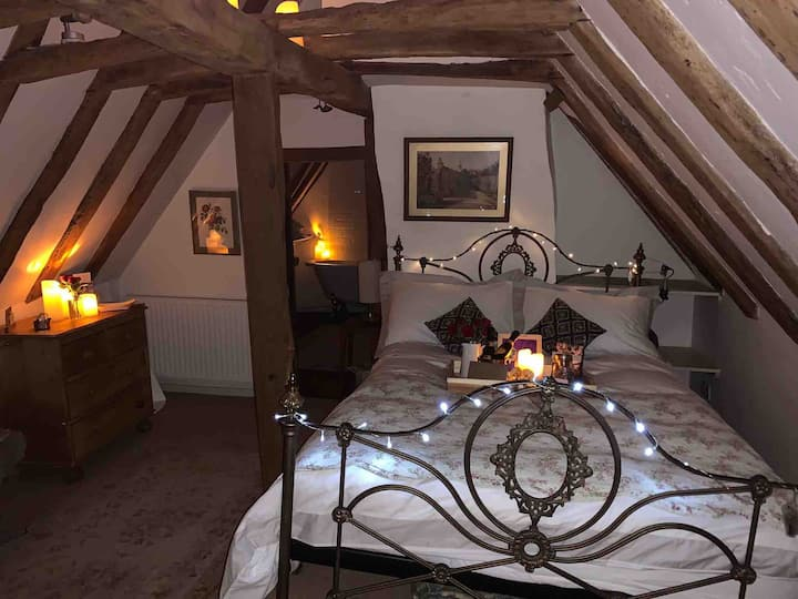 Luxury attic en-suite room with roll top bath
