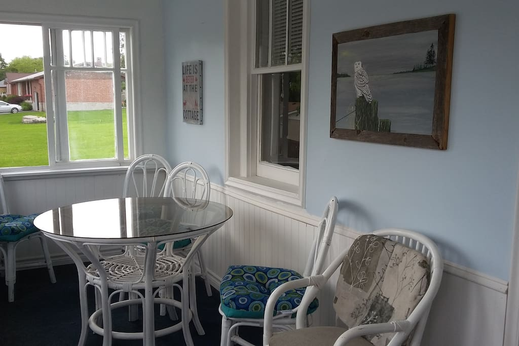Enclosed Sunporch with a view to the river.
