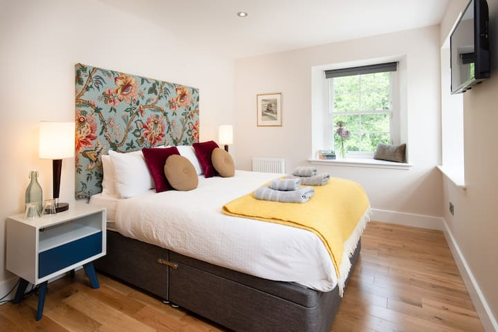 Luxurious boutique room in old Mill House