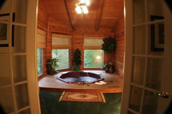 Private hot tub inside cabin.