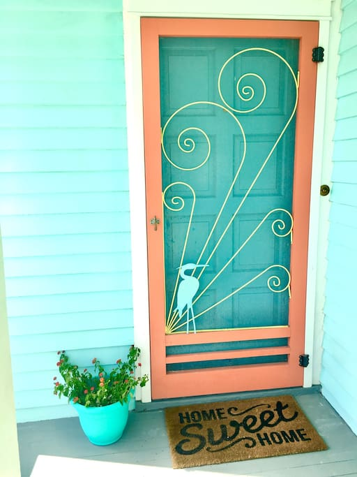 Home Sweet Home! Walk through the throw back screen door into a happy beach house that has recently been updated with a vintage style.