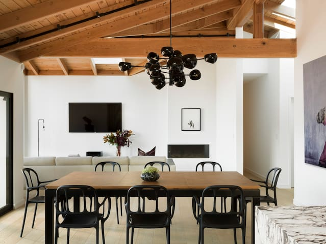 Vaulted beams connect the kitchen with dining and living areas.