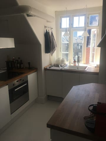 Kitchen with lots of table space and dishwasher